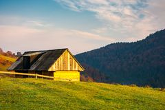 Wooden barn in village outskirts. On hill in morning light. beautiful autumn countryside royalty free stock image