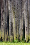 Wooden barn wall. Wooden wall of an old barn with grass in foreground Stock Photo