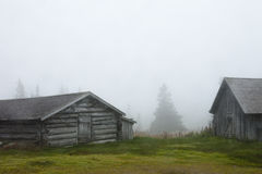 Wooden barns in fog, Sweden. Wooden barns and Farmhouses in autumnal fog Royalty Free Stock Photography