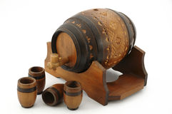 Wooden barrel. Small wooden barrel with four wooden cups on white background Stock Image