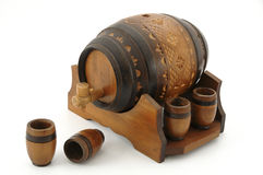 Wooden barrel. Small wooden barrel with four wooden cups on white background Stock Photo