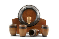 Wooden barrel. And four wooden cups on white background Stock Images