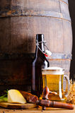 Wooden barrel with beer and food. Still life with wooden beer barrel, mug, bottle and food stock photos