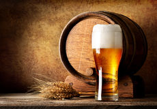 Wooden barrel and beer Stock Image