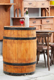 Wooden barrel with bottles of wine and glass Royalty Free Stock Photo