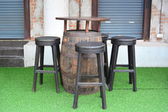 Wooden barrel chairs and table in beer garden. Stock Photos