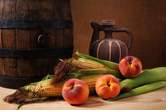Wooden barrel and corn Stock Images