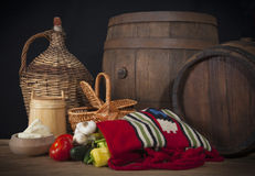 Wooden barrel and ethnic bag Stock Image