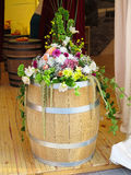 Wooden barrel with flower decoration Royalty Free Stock Image