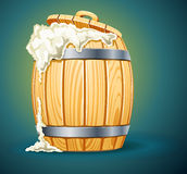 Wooden barrel full of beer with foam Royalty Free Stock Image