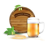 Wooden barrel, glass of beer, hops and barley Stock Images