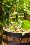 Wooden barrel with glass of white wine. Stock Photo