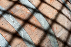 Wooden barrel with a grid shadow Royalty Free Stock Photo