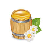 Wooden barrel with honey and flowers isolated Royalty Free Stock Images