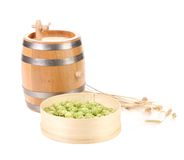 Wooden barrel and hops in basket. Stock Photos
