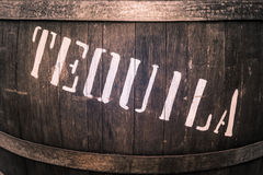 Wooden barrel with iron rings with the word. 'tequila' in white royalty free stock photo