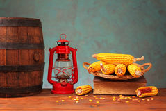 Wooden barrel, lantern and corn Stock Photos