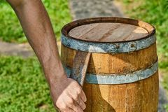Oak Barrel. Opening the barrel with a chisel and hammer. Wooden barrel for 20 liters. Wooden barrel covered with wax. Opening the barrel with a chisel and hammer stock image