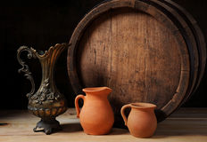 Wooden barrel, the metal jug  and earthenware Royalty Free Stock Photography
