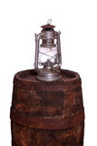 Wooden barrel with oil lamp Stock Image