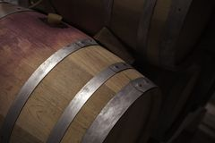Wooden barrel with red wine in dark winery. Close up photo with selective focus Royalty Free Stock Photography