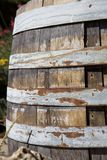 Wooden barrel with some rust. From the side stock image