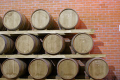 Wooden barrel in a winery Royalty Free Stock Photo