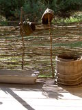 Wooden barrel and wooden trough. S  at the fence of willow branches Stock Images