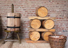 Wooden barrels. Wine barrels and traditional squeezer of wood for grapes Royalty Free Stock Photo