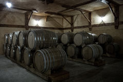 Wooden barrels of aged cognac at cellar of Brandy Factory Noy of Yerevan. Armenia Royalty Free Stock Images