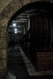 Wooden barrels of aged cognac at cellar of Brandy Factory Noy of Yerevan. Armenia Stock Image