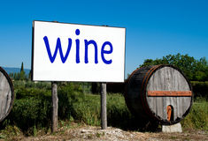 Wooden barrels and billboard for wine sales Royalty Free Stock Photo