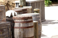 Wooden Barrels and Boxes on Shipping Dock Stock Image