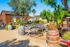 Wooden barrels and cart Stock Images
