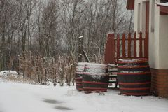 Wooden barrels covered with snow Stock Photography