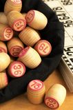 Wooden barrels with lotto games in red digits Stock Photo