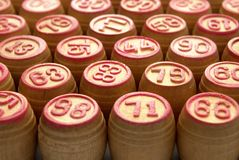 Wooden barrels with lotto games in red digits Stock Photos