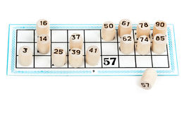 Wooden barrels lotto numbers on the card carton Royalty Free Stock Photos