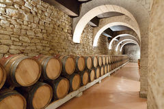 Wooden barrels in old winery Royalty Free Stock Images