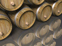 Wooden barrels and reflection. Stacked wooden barrels reflecting on light foreground Stock Images