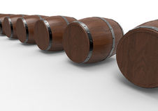 Wooden barrels row. 3D rendered illustration of  a row of wooden barrels. The composition is  on a white background with shadows Royalty Free Stock Photos