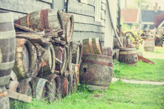 Wooden barrels. Vintage wooden beer barrels near house royalty free stock photo