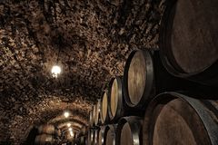 Wooden barrels with whiskey. In dark cellar royalty free stock images