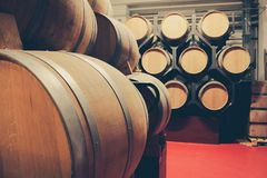 Wooden barrels with whiskey in dark cellar. royalty free stock photo