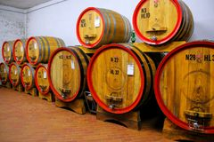 Wooden barrels in a wine cellar in Montalcino. Val d`Orcia, Tuscany, Italy. Montalcino is famous for its Brunello di Montalcino wine stock photos