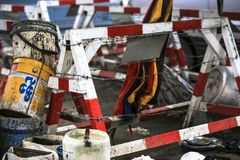 Wooden barricade entry barrier along road construction site repair work stock images