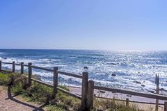 Wooden Barrier Along Walkway Against Seascape Royalty Free Stock Image