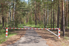 Wooden barrier blocking way to wood Stock Photos