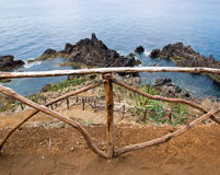 Wooden barrier in front of the Atlantic Ocean Royalty Free Stock Photography