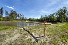 Wooden barrier on the lake in Southern Poland Stock Photo